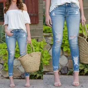 BRYNN Distressed Light Wash Skinny Jeans
